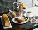 Privé afternoon tea with glass champagne