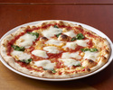 Pizza with mozzarella cheese, basil  flavored with tomato sauce